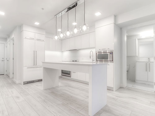 Modern white kitchen with natural light beautifully lighting up the space